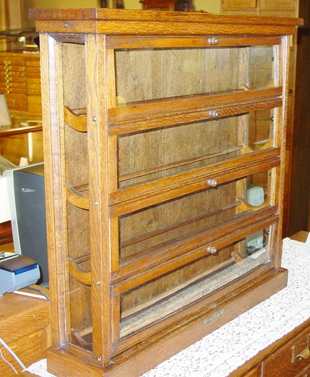 Quartered oak country store ribbon cabinet case