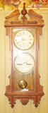 Waterbury oak double dial calendar clock